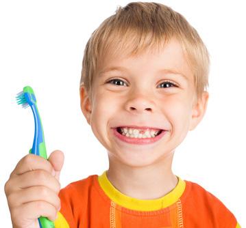a kid brushing his gapped teeth
